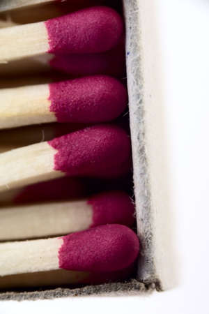 matches with red heads as macro shoot photo