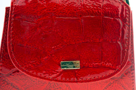 red leather wallet with golden plate macro shot photo