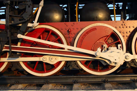 pair red wheel of old steam train with connecting rod photo