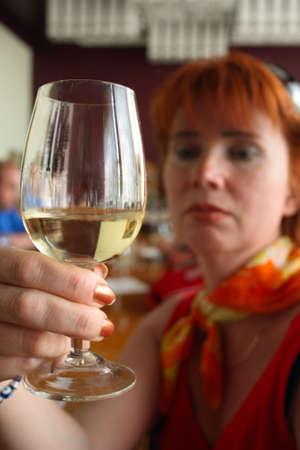 woman tasting white wine