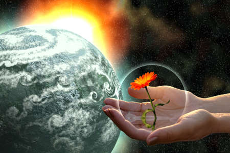woman hands giving flower to grey planet in open cosmos Stock Photo