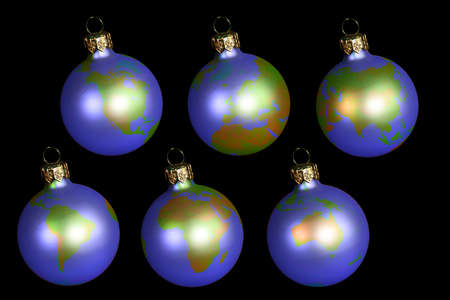 christmas balls with earth isolated on black photo
