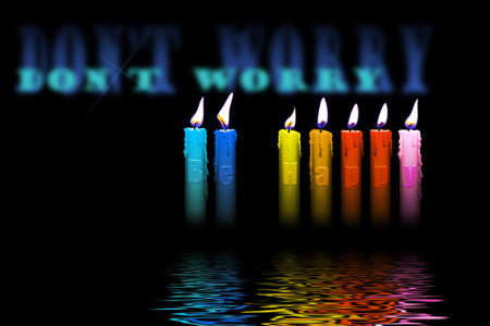 colored candles with dont worry be happy letters inside flooding in water photo
