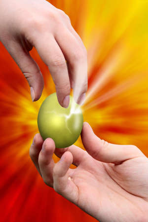 male hand giving easter golden egg to woman hand