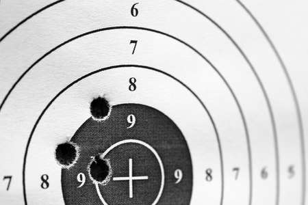 black and white paper target for practice with three holes photo