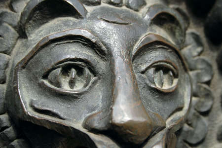 castings: bronze lion eye closeup on doorknocker in Kiev, Ukraine, memorial Golden Gate
