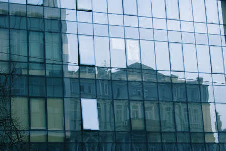 reflecting in business center mirror windows another building with one of the numerous window another angle, Ukrainian capital - Kyiv photo