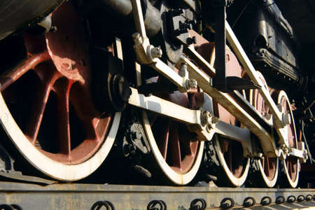 connecting rod: red wheels of old steam train with connecting rod Stock Photo