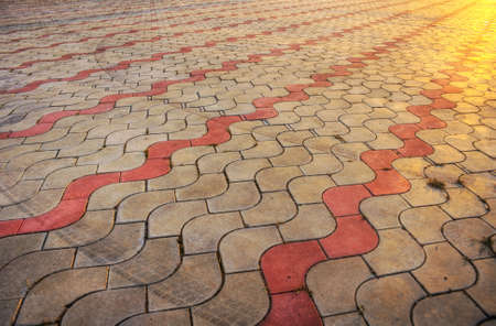 sidewalk pile pattern with track of protector in sunset - HDR picture photo