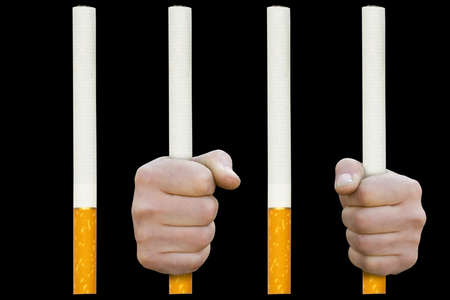 grates: in cigarette prison. Man fists on grates from cigarettes