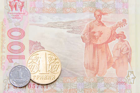 kopek: One kopek and hrivna coins against one hundred bill. You must save every coin to get more money. Ukrainian currency.