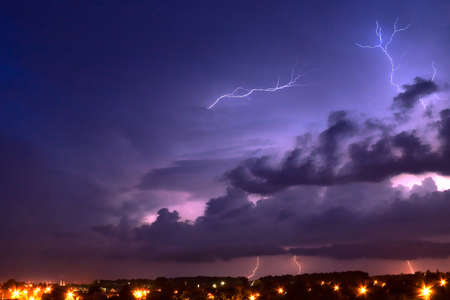 Lightning in the night over small town photo
