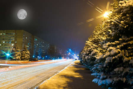 wintery snowy: Night snowy road in the small town in Ukraine