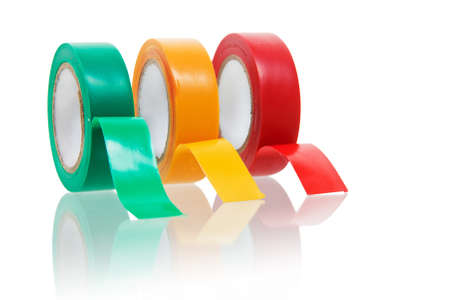 Three colors insulating tapes isolated on white with reflections Stock Photo