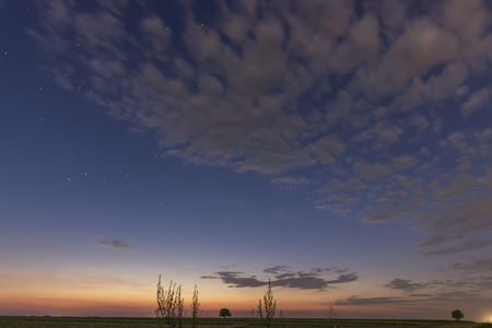 ursa minor: Clouds and beautiful stars just after sunset. With Constellations Lynx, Ursa major, Leo minor, Cancer