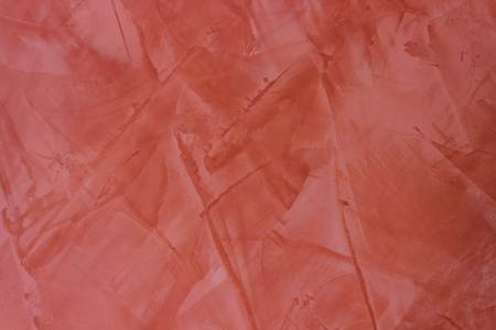 stucco: Wall texture red stucco Paint background.
