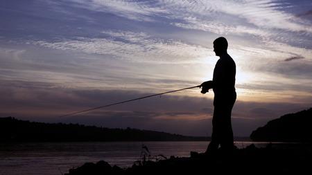 jigging: Silhouette of Fisherman on sunset, Fisherman Casting