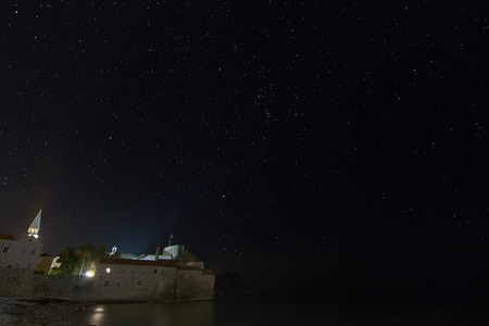 constellations: Fortress and starry night,  Constellations Orion, Canis Minor, Sanis Major, Gemini. Budva, Montenegro