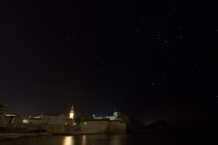 orion: Fortress and starry night,  Constellations Orion, Canis Minor, Sanis Major, Gemini. Budva, Montenegro