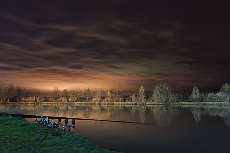 fishing scene: Night Fishing, Carp Rods, Cloudscape reflection on lake