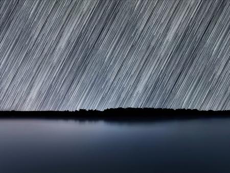 polaris: Star Trails, Beautiful Blue Night reflection Stock Photo