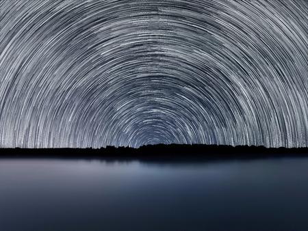 Star Trails, Beautiful Blue Night reflection Stock Photo