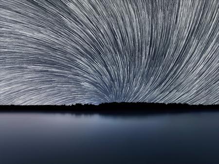 stary: Star Trails, Beautiful Blue Night reflection Stock Photo