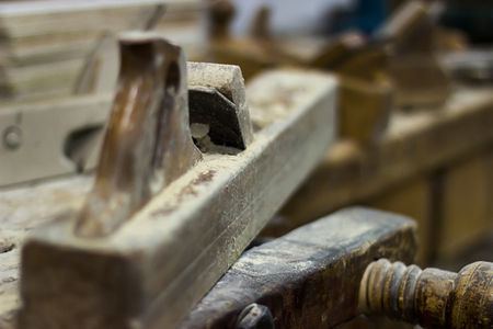 cabinet maker: Old plane on a carpenter work bench Wood planer, Hand plane Selective focus and shallow Depth of field