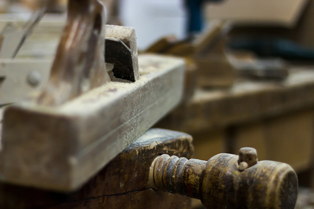 wood planer: Old plane on a carpenter work bench Wood planer, Hand plane Selective focus and shallow Depth of field