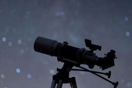 billions: Silhouette of Telescope in real night sky. Blurred night sky. Blurred milky way. Refractor type telescope