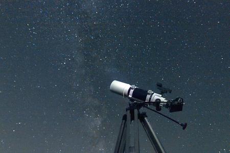 billions: Telescope in real night sky. Blurred night sky. Blurred Milky way. Refractor type. telescope Stock Photo