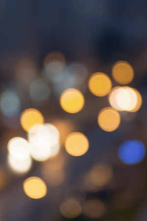 Abstract blurred night city lights..Blur backgrounds concept. Blur of cityscape in Blue hour.  Blur wallpaper concept. Blurry night urban. Stock Photo