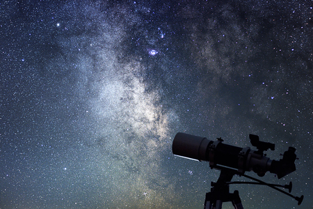 Telescope in starry night. Milky way and telescope. Astronomy