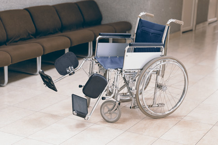 health care facilities: Empty wheelchair parked in hospital Stock Photo