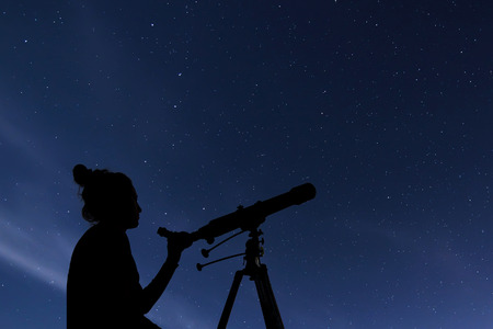 capricornus: Woman with astronomical telescope. Starry night  Constellations, Ursa Major, Ursa Minor, Draco Starry night, Dark sky Stock Photo