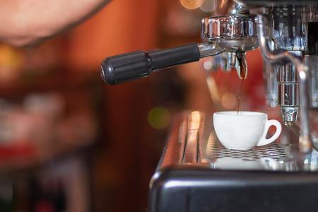 capucinno: Espresso machine making coffee, golden espresso flowing. Coffee espresso