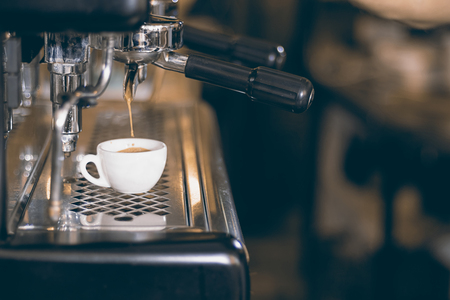capucinno: Coffee espresso. Espresso machine making coffee, golden espresso flowing.