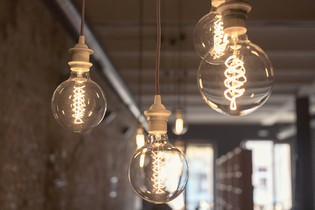 chandelier: Vintage style round light bulbs hanging from the ceiling