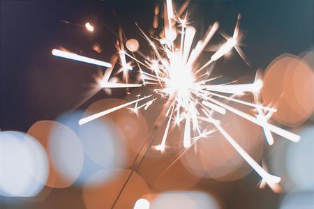 Night background with a sparkler. Sparkler  Bokeh Colorful sparkler. Shallow focus Archivio Fotografico