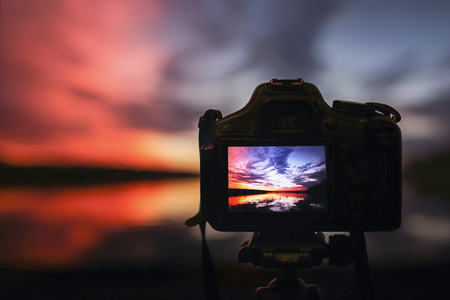 Camera capturing sunset. Photography view landscape. Camera the night view