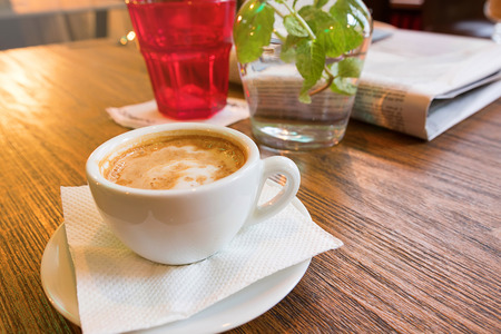 acidity: Coffee cup of cappuccino. A cup of cappuccino on the table at the bar.