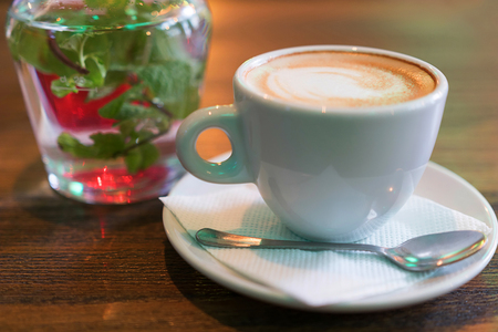 Coffee cup of cappuccino. A cup of cappuccino on the table at the bar.
