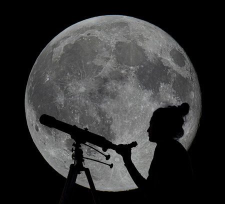spectra: Silhouette of a woman with telescope full moon in the background. Moon Observing.