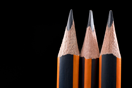 pencil point: Closeup Of Sharp Pencil. Pencil point close-up on black background.