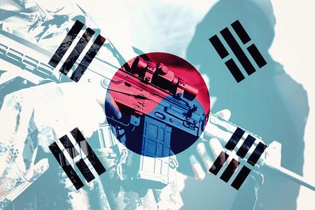 Militair met machinegeweer met nationale vlag van Zuid-Korea Stockfoto - 77511054