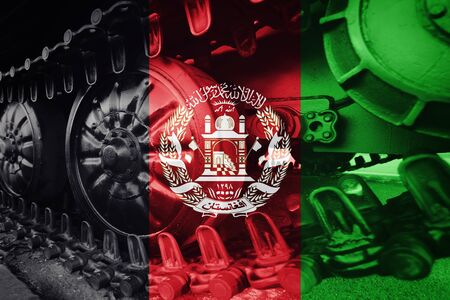 Military tank close-up Caterpillar Track with Afghanistan flag Background. Stock Photo