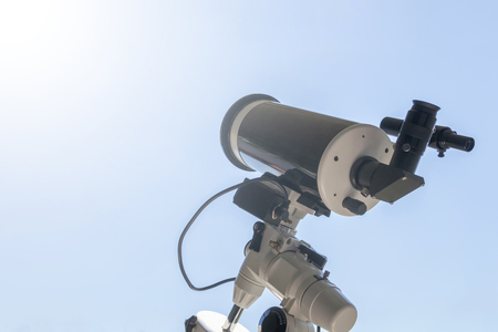 Observing the Sun with telescope. Solar eclipse telescope solar filter. Stock Photo