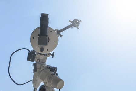 Solar eclipse observing with telescope. Telescope with solar filter. Stock Photo