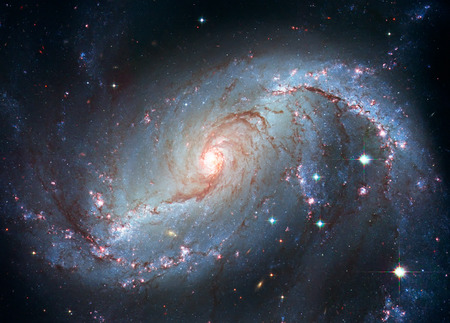 Stellar Nursery NGC 1672. Spiral galaxy in the constellation Dorado Elements of this image are furnished by NASA.