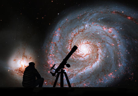 Man with telescope looking at the stars. Whirlpool Galaxy. Spiral galaxy M51 or NGC 5194 Elements of this image are furnished by NASA.